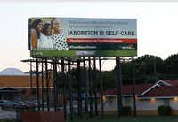 """A billboard put up by the Dallas-based Afiya Center proclaims """"abortion is self-care"""" and includes the hashtag #TrustBlackWome on Interstate 35E near the Illinois Avenue exit in Oak Cliff, the billboard follows another recent abortion message, the Black Pro Life Coalition's assertion that """"abortion is not healthcare.""""(Irwin Thompson/Staff Photographer)"""