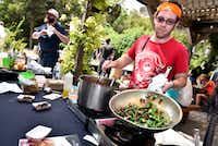 Chef Mark Wooton of Garden Cafe prepared a bamya stew with okra, tomato, lamb and bacon during the seventh annual Okrapalooza at The Lot in Dallas.(2017 File Photo)