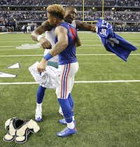 Former Dallas Cowboys wide receiver Dez Bryant and New York Giants wide receiver Odell Beckham Jr. hug as they exchange jerseys after a game at AT&T Stadium in 2014. Beckham Jr. has joined Colin Kaepernick and other athletes in a new ad campaign from Nike.(DMN file photo)