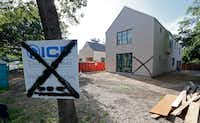 Neighbors and the home-builder believe this house at Snow White and Hockaday drives was tagged because someone is unhappy with new homes being built in the Northaven Park neighborhood of northwest Dallas.(Nathan Hunsinger/Staff Photographer)