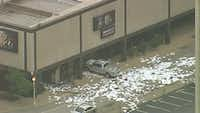 Papers lie scattered after a truck rammed into the Fox4 news studio Wednesday morning in downtown Dallas.(KXAS-TV (NBC5))