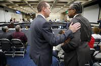 Dallas City Council member Philip Kingston chats with Dallas County Commissioner John Wiley Price on Wednesday before Price addressed the Council regarding Kingston's proposal last week that Sandy Greyson, who is white, replace Dwaine Caraway as mayor pro tem instead of nominees Casey Thomas and Tennell Atkins, who both are black.(Tom Fox/Staff Photographer)