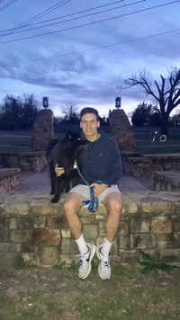 Gregory Ferrara wiith Virginia Whittington's dog Ray during a walk at White Rock Lake earlier this year.(Virginia Whittington)