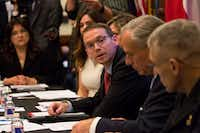 "<p><span style=""font-size: 1em; background-color: transparent;"">The State Auditor's Office on Tuesday criticized the Texas Education Agency's handling of two multi-million-dollar contracts -- one, affecting special education students. Commissioner Mike Morath, center, shown during a May roundtable on school safety at the Texas Capitol, said he's launched a ""a top-to-bottom review of contract processes.</span><br></p>(Ana Ramirez/AP)"