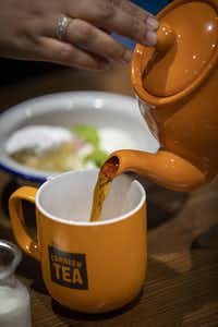 A diner pours a cup of tea at Fish & Fizz.(Smiley N. Pool/Staff Photographer)