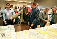 McKinney Mayor George Fuller (right) and wife Maylee looked over maps of possible U.S. Highway 380 alignment routes  during a public meeting at the Sheraton Hotel in McKinney in April.(Stewart F. House/Special Contributor)