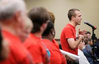 Isaac Davis, a member of the North Texas Democratic Socialists, speaks in favor of a 3 percent raise for Dallas ISD support staff (custodians, office   assistants, cafeteria workers, etc.) during a board of trustees meeting on Aug. 23, 2018. (Brandon Wade/Special Contributor)
