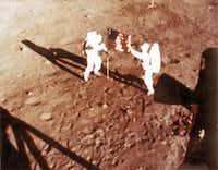 "In this NASA handout file photo taken on July 20, 1969 US astronauts Neil Armstrong and ""Buzz"" Aldrin deploy the US flag on the lunar surface during the Apollo 11 lunar landing mission. - Neil Armstrong's sons and the director of a new biopic on the space hero are hitting back against criticism that the film is unpatriotic because of the lack of a flag-planting scene. In a statement issued on August 31, 2018, Rick and Mark Armstrong said ""First Man,"" starring Ryan Gosling, was intended to depict their father's journey to the moon and delve into ""the man behind the myth.""(HANDOUT/AFP/Getty Images)"