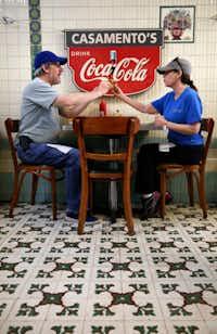 Deborah Bilsky hands her husband, Steve Bilsky, a bite of her sandwich while eating lunch in New Orleans.<div><br></div>(Rose Baca/Staff Photographer)