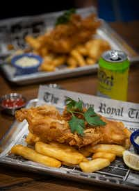 The house favorite fish and chips is the most popular item on the menu at Fish & Fizz in Richardson.(Smiley N. Pool/Staff Photographer)