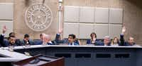 Park Board President Bobby Abtahi (center) calls for a vote on sending the Fair Park First-Spectra contract to the City Council.(Shaban Athuman/Staff Photographer)