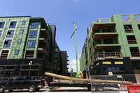 Among the residences going up in Plano are these downtown structures, under construction in September.(Nathan Hunsinger/The Dallas Morning News)