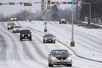 Here's a driving nightmare: Traffic moves slowly on Garland Road near White Rock Lake as icy weather descended on North Texas in February 2015.(Smiley N. Pool/Staff Photographer)