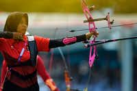 Indonesia's Diananda Choirunisa competes in the archery recurve women's individual final round against China's Zhang Xinyan at the 2018 Asian Games in Jakarta on Aug. 28, 2018(Chaideer Mahyuddin/Agence France-Presse)
