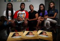 ShaQuaila Jacobs, 36,  center, poses for a photograph with her children, (from left) Trameicia Jacobs, 17; ShaDarrion Jacobs, 20; Ashanti Ferrell, 16; and ShaNaia Ferrell, 15, at their apartment in Dallas on Thursday, March 22, 2018. NeQuacia Jacobs was killed in a shooting after looking out her apartment window in February.(Jae S. Lee/Staff Photographer)