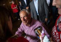 Texas Gov. Greg Abbott greets supporters before speaking at a Collin County Republican Party event Monday in McKinney.(Ryan Michalesko/Staff Photographer)