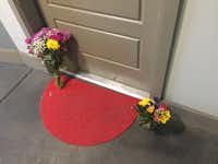 "<p>Flowers have ben placed at the front door of <span style=""font-size: 1em; background-color: transparent;"">Botham Shem Jean, who Dallas police say was shot Thursday night by Amber Guyger, an off-duty police officer who mistakenly thought her apartment was his. Guyger was in uniform.</span></p>(Jennifer Emily/Staff)"