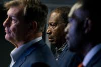State Sen. Royce West, D-Dallas, and Dallas Mayor Pro Tem Casey Thomas listened as Mayor Mike Rawlings spoke at a news conference Saturday at Paul Quinn College.(Shaban Athuman/Staff Photographer)