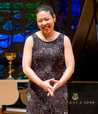 Van Cliburn International Piano Competition silver medalist Joyce Yang acknowledges applause before performing.(Robert W. Hart/Special Contributor)