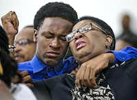 Allison Jean raises her hands in the air as she leans on her son, Brandt, 15, during a prayer service for her son and Brandt's brother Botham Shem Jean at the Dallas West Church of Christ on Sunday, September 9, 2018 in Dallas.(Shaban Athuman/Staff Photographer)