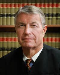 Justice Douglas Lang(Margaret Wolf)