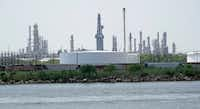 Storage tanks at a refinery along the waterway are shown in Port Arthur, Texas. (David J. Phillip/AP)