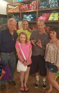 "Dallas police Officer Amber Guyger with her family at Joe's Crab Shack in 2016. Guyger's brother-in-law, Noe Garza, has been accused of making white supremacist hand signals in this photo. He said he is making a ""6"" and a ""9"" because they were celebrating Guyger's father's birthday.(Facebook)"