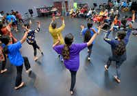 Dancers from the cast of <i>The Red Pashmina&nbsp;</i> rehearse at the Irving Arts Center on Sept. 9.(Robert W. Hart/Special Contributor)