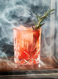 "A ""Smoke and Rosemary"" at Beau Nash cocktail bar at Hotel Crescent in Dallas(Brandon Wade/Special Contributor)"