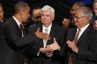 Regulations that resulted after the crisis are beginning to be rolled back by the current Republican-controlled Congress. Above, President Barack Obama congratulated Sen. Christopher Dodd and Rep. Barney Frank in 2010 after he signed the Dodd-Frank Wall Street Reform and Consumer Protection financial reform bill. (Charles Dharapak/AP)
