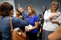 Richardson homeowner Melinda Hutchenrider (Center) visits with fellow homeowners who attended Thursday's special meeting at the North Texas Municipal Water District headquarters in Wylie.(Tom Fox/Staff Photographer)