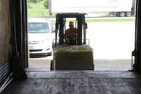 Russell Schieck loads a truck with supplies.(Rand Jenkins/Texas Baptist Men)