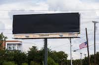A billboard  at the intersection of Preston Road and President George Bush Turnpike, near Baylor Scott & White Medical Center - Plano, appeared covered on Friday(Ashley Landis/Staff Photographer)