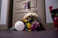 Flowers at the front door of Botham Shem Jean, who Dallas police say was shot Thursday by Amber Guyger, an off-duty police officer who mistakenly thought her apartment was his, photographed on Monday, September 10, 2018 at the South Side Flats in Dallas. Guyger was in uniform. (Shaban Athuman/ The Dallas Morning News)(Shaban Athuman/Staff Photographer)