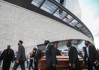 Members of the clergy and community carried empty coffins around AT&T Stadium in Arlington in protest officer slayings. (Ryan Michalesko/Staff Photographer)
