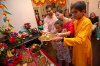 Hosts Sapna Punjabi-Gupta and husband Saurabh Gupta join son Aditya, 13, and daughter Mihika, 9, during a Ganesha Chaturthi celebration and dinner in Irving.(Allison Slomowitz/Special Contributor)