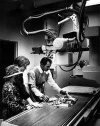 Technician Clem Miller X-rayed Halloween candy for 12-year-olds Aaron Luneau and Matt Bray, both of Farmers Branch, on Oct. 31, 1985.(Milton Hinnant/The Dallas Morning News)