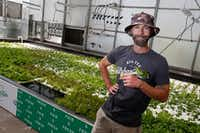Drew Demler manages Big Tex Urban Farms.(Nathan Hunsinger/Staff Photographer)