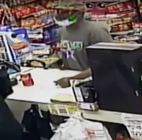 One robber wore a Cowboys shirt and had a surgical mask on his chin.(Coppell Police Department)