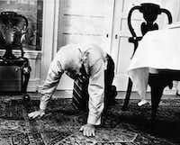 "Dallas billionaire H. L. Hunt, 83, demonstrates his yoga exercise called ""creeping,"" which he does for two or three minutes several times a day. He also has yoga lessons twice a week and maintains a strict regimen of healthy foods. (1972 File Photo/The Associated Press)"