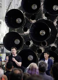 SpaceX founder and chief executive Elon Musk, left, speaks after announcing Japanese billionaire Yusaku Maezawa, right, as the first private passenger on a trip around the moon, Monday, Sept. 17, 2018, in Hawthorne, Calif. (AP Photo/Chris Carlson)(Chris Carlson/AP)