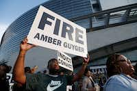Demonstrators at AT&T Stadium Sunday night demanded Dallas Police fire Amber Guyger, who shot and killed Bortham Jean in his apartment two weeks ago.(Brandon Wade/AP)