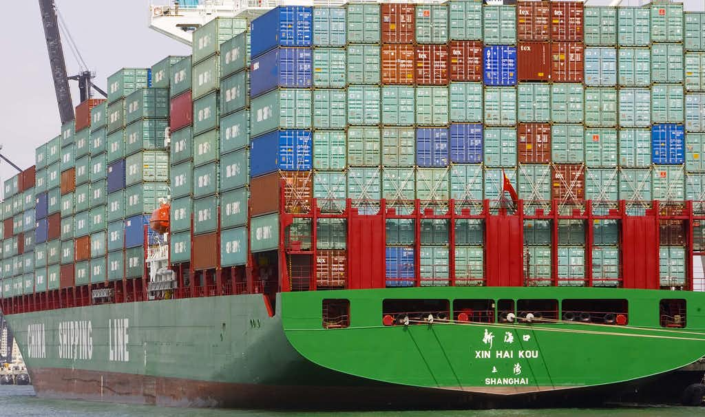 Cargo was stacked high on a China Shipping Line freighter at Miami Beach, Fla., in 2006.(File Photo/Agence France-Presse)