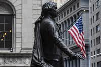 A statue of George Washington is near the New York Stock Exchange building along Wall Street in New York City.(Stephanie Keith/Getty Images)