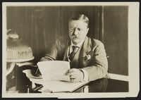 Theodore Roosevelt, the 26th president, reads at his desk in 1906. He was in office from 1901 to 1909.(Library of Congress/The New York Times)