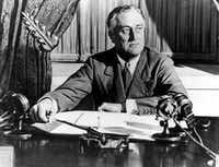 "U.S. President Franklin D. Roosevelt delivers his first radio ""Fireside Chat"" in Washington in March 1933. (The Associated Press)"