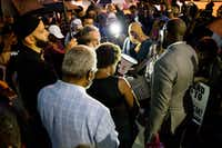 Pastor Michael W. Waters lead prayer following a Mothers Against Police Brutality candlelight vigil for Botham Shem Jean at the Jack Evans Police Headquarters on Friday, September 7, 2018 in Dallas. He was shot by a Dallas police officer who mistook his apartment for hers on Thursday night. (Shaban Athuman/Staff Photographer)