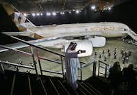 An Emirati man takes a selfie in front of a new Etihad Airways A380 in Abu Dhabi, United Arab Emirates. (2014 File Photo/The Associated Press)