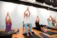 Karen Cangemi, Joshua Lloyd, Christine Cerny (left to right) participate in a trauma-sensitive yoga session offered by the non-profit Warrior Spirit Project on Friday, July 21, 2017 at Studio 4 in the Bishop Arts Co-op in Dallas. Warrior Spirit Project seeks to help military veterans and first-responders heal from trauma through yoga, a support dog program and gardening.(Jeffrey McWhorter/Special Contributor)