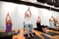Karen Cangemi, Joshua Lloyd, Christine Cerny (left to right) participate in a trauma-sensitive yoga session offered by the non-profit Warrior Spirit Project on Friday, July 21, 2017 at Studio 4 in the Bishop Arts Co-op in Dallas. Warrior Spirit Project seeks to help military veterans and first-responders heal from trauma through yoga, a support dog program and gardening. (Jeffrey McWhorter/Special Contributor)